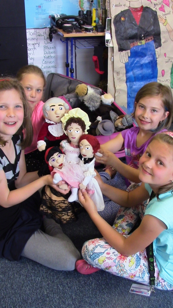 second-grade-girls-with-famous-people-mozart-jane-austen-carmen-emily-dickinson