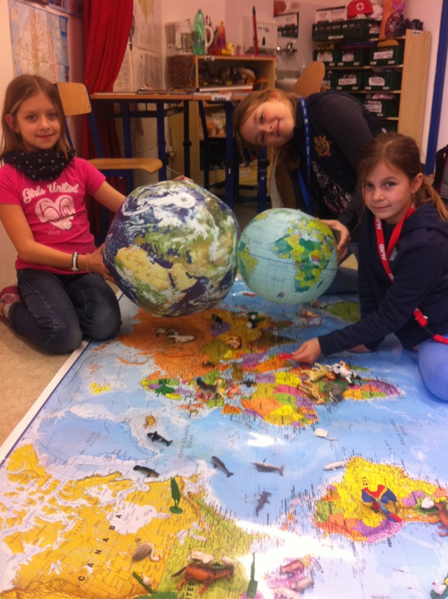 third-graders-with-globes-and-world-map-animal-placement
