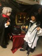 Count Dracula and the Grim reaper at the Halloween table